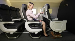 BA promotional image of a passenger using a tablet attached to the seat back